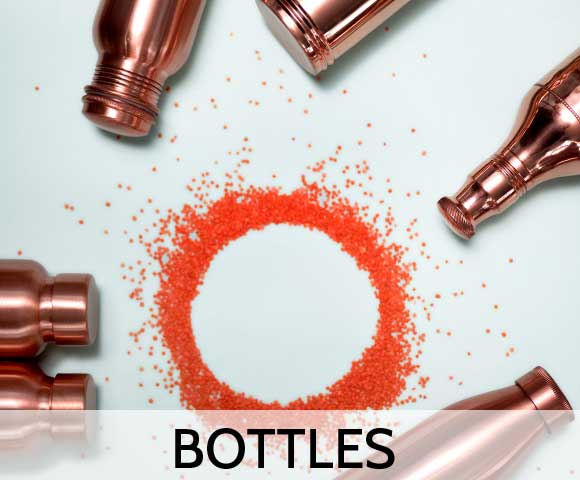 Copper Bottles placed in a circle with orange