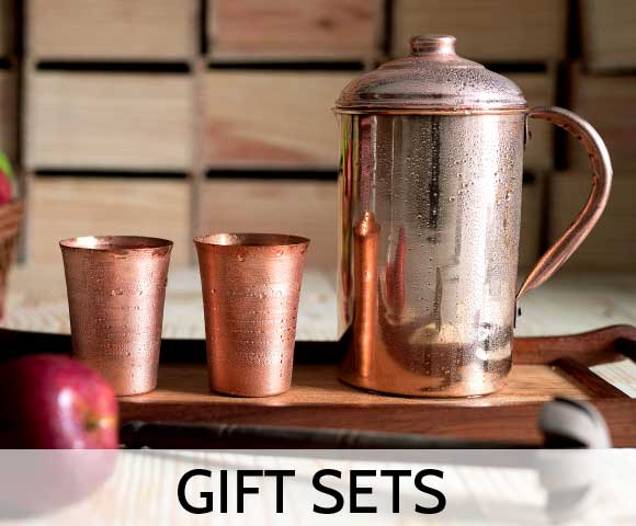 Set of Copper jug and two copper glasses in a cold state