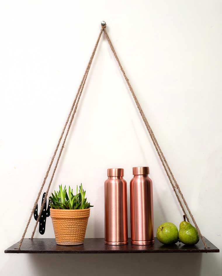 Copper Bottles in a hanging self with plant pot and two pears