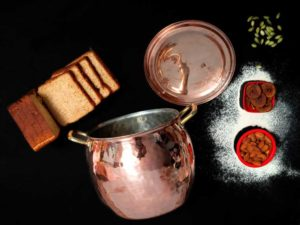 Copper Stock Pot with breads in black background